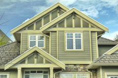 New Home House Exterior. House exterior roofing and siding detail Stock Photo