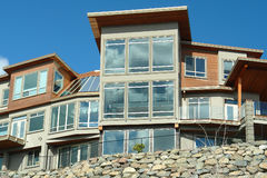 New Home House Exterior Windows. Large new multi level home for sale stock photos