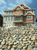 New Home House Rock Wall. New residential house built in British Columbia, Canada royalty free stock image