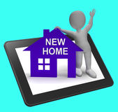 New Home House Tablet Shows Buying Property And Moving In Stock Image