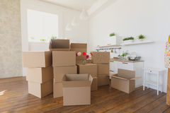 New home owners unpacking boxes, big cardboard boxes in new home. Moving to a new apartment concept royalty free stock photography