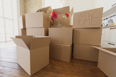 New home owners unpacking boxes, big cardboard boxes in new home. Moving to a new apartment concept stock photography