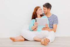 New home real estate. Home life couple with tablet Royalty Free Stock Images