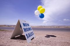 New home sales. Sign near highway Royalty Free Stock Images