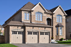 New home with a triple garage. New brick house with a triple garage Stock Photo