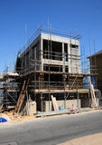 A new home under construction. An apartment block under construction on a sunny day Stock Photo
