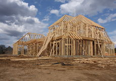 New home under construction. Wooden frame of new home under construction Royalty Free Stock Photos