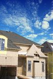New home under construction. Against blue cloudy sky Royalty Free Stock Photography
