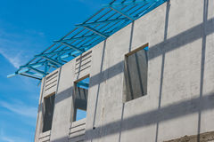 New home under construction using steel frames against cloudy sk Royalty Free Stock Photo
