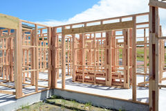 A new home under construction. A new wooden structured home under construction Royalty Free Stock Images