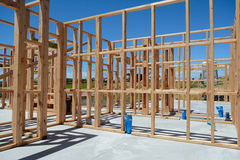 A new home under construction. A new wooden structured home under construction royalty free stock photo