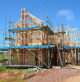 A new home under construction. A new wooden structured home under construction Royalty Free Stock Photos
