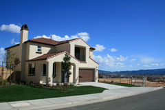New Home with Vacant Lot. Newly constructed home with vacant lot next door in Sunny Southern California Royalty Free Stock Images