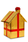New home wrapped in gold paper with ribbon and bow