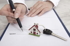 New homeowner signing contract of house sale Royalty Free Stock Photos