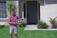 New Homeowner - Sold Sign. Man in front of home with Sold Sign Stock Photography