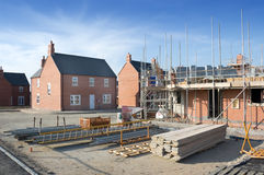 New Homes. For sale and in the foreground a new house under construction royalty free stock images