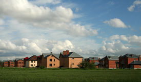 New Homes. Row of the new houses on background of the spring landscape Stock Photos
