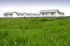 New homes in green field Stock Photos