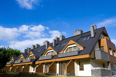 New Homes over blue cloudy sky Royalty Free Stock Image
