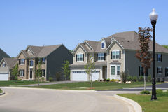 New homes in the suburbs. Two new houses on a suburban street Royalty Free Stock Photography