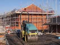 New build houses with equipment in Cheshire UK. New homes under construction on a building site in Cheshire England United Kingdom Europe stock photography