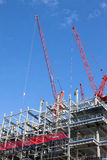 New Homes under Construction. A construction cranes, new homes Royalty Free Stock Photos