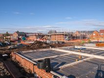 New homes under scaffolding in Cheshire England UK. New build houses on a housing estate in Cheshire England United Kingdom Europe royalty free stock photo