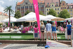 New Horizons Cinema. People on the beach in the center of the Old Town on the Salt Square as part of New Horizons Cinema, Poland's Largest Art House Cinema on 3 stock image