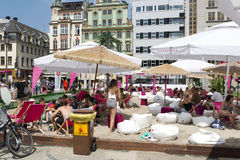 New Horizons Cinema. People on the beach in the center of the Old Town on the Salt Square as part of New Horizons Cinema, Poland's Largest Art House Cinema on 3 stock photo