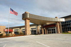 New Hospital. Front entrance of new hospital with American flag flying in the wind stock photo