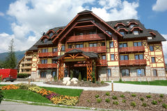 New hotel and flowers in Tatranska Lomnica. Royalty Free Stock Images