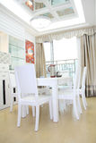 New house. Hall with white desk and chairs Royalty Free Stock Photography