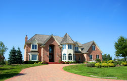 New house. Beautiful new house, grass and blue sky Royalty Free Stock Photos