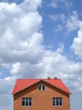 New house. Landscape with the new built house against the blue sky Stock Images