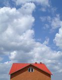 New house. Landscape with the new built house against the blue sky Royalty Free Stock Photo
