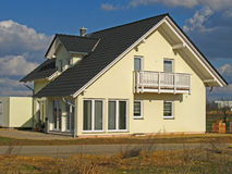New house. New constructed, yellow family - house Royalty Free Stock Photography