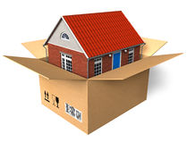 New house in box. New house in cardboard box isolated over white background Royalty Free Stock Photos