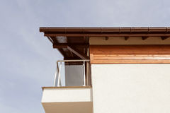 New house with brown rain gutter, white wall and balcony. Royalty Free Stock Photos