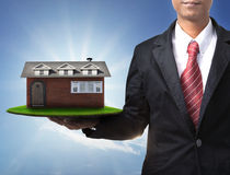 New house on business man hand Stock Image