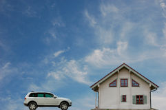 New House and Car. Against blue Sky royalty free stock image