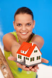 New house concept. Young woman worker with miniature house Stock Photography