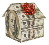 New House Concept 2. A house made of one hundred dollar bills with a red bow on top Stock Photos