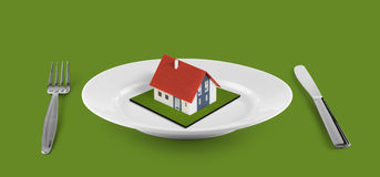 New house concept on white plate Stock Photo