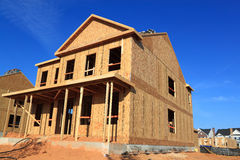 New House Construction. On blue sky background Stock Photography