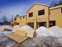 New house construction. Exterior framing of new town house construction in the suburbs Stock Images