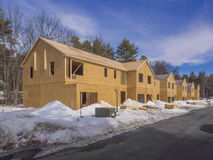 New house construction. Exterior framing of new town house construction in the suburbs Stock Photos