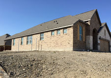 A new house construction in community. A nice new house construction background Royalty Free Stock Images