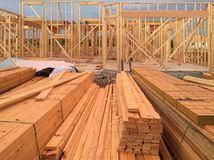 New house construction on community. A new house construction on sunset background Stock Photography