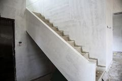 New house construction with concrete staircase. New house construction interior with concrete staircase at building site Royalty Free Stock Image